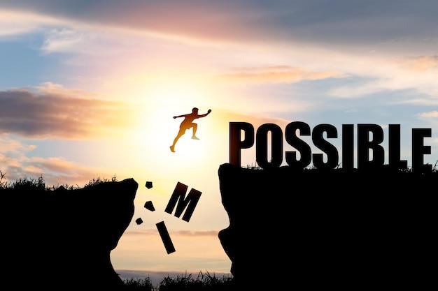 Silhouet man springen over onmogelijk en mogelijk