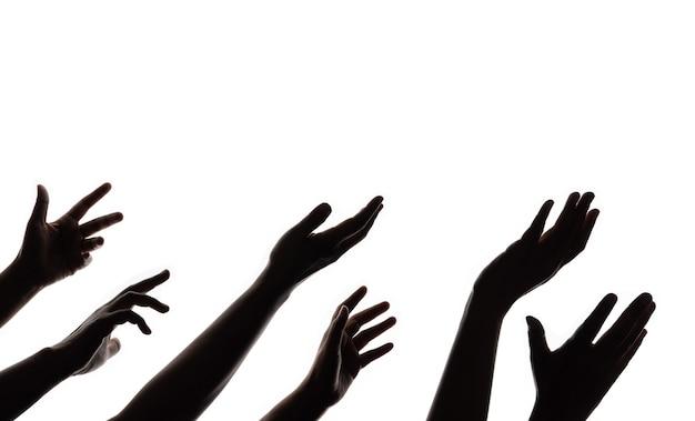 Silhouet van bedelende handen