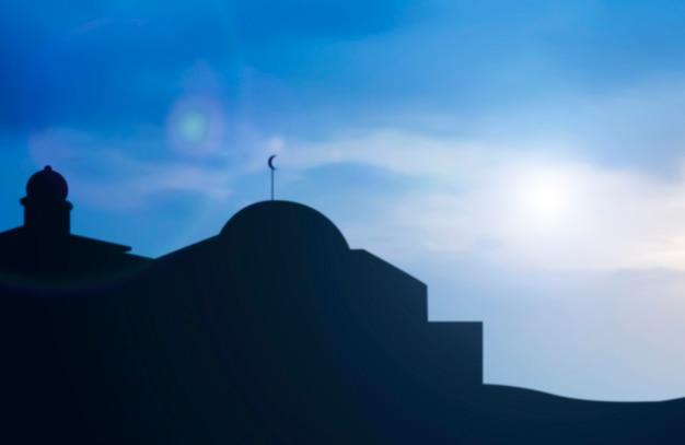 Silhouet van de moskee met een zonsopganghemelachtergrond