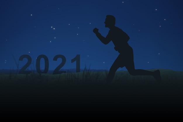 Silhouet van een man die loopt naar 2021. gelukkig nieuwjaar 2021