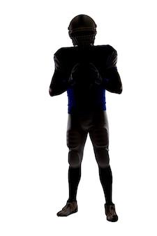 Silhouet van een voetballer met een blauw uniform op een witte muur