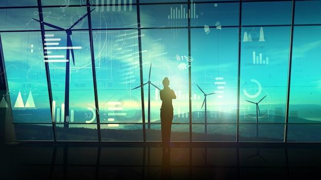 Silhouet van een zakenvrouw staat op kantoor met grote ramen die uitkijken op de windenergiecentrales, en ervoor staat een virtuele infographic