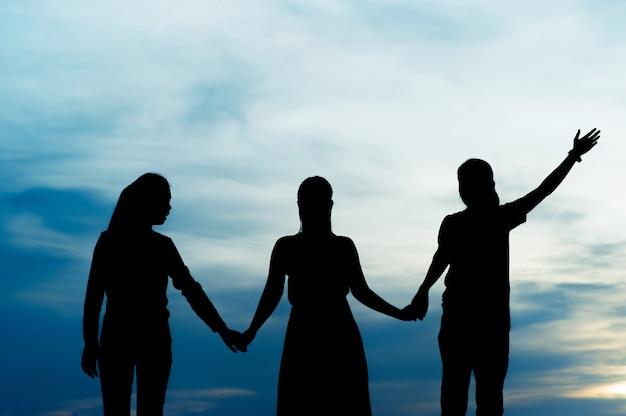 Silhouet van teamleiderschap, teamwerk en teamwerk en heerlijke silhouetconcepten