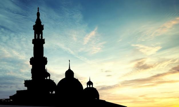 Silhouetmoskee of masjid-koepel op de achtergrond van de zonsondergangtijd
