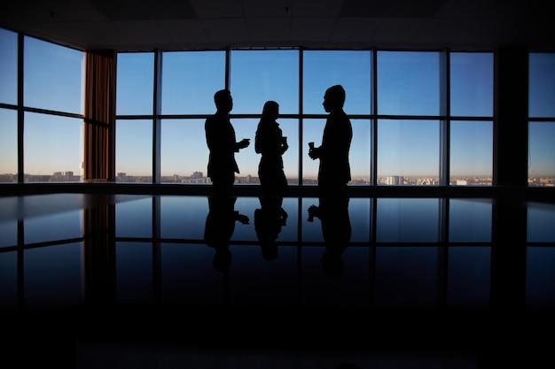 Silhouetten van zakenlui achtergrond
