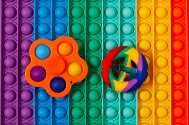 Siliconen speelgoed snapperz en eenvoudig kuiltje op sensorisch oppervlak pop it push pop fidget speelgoed