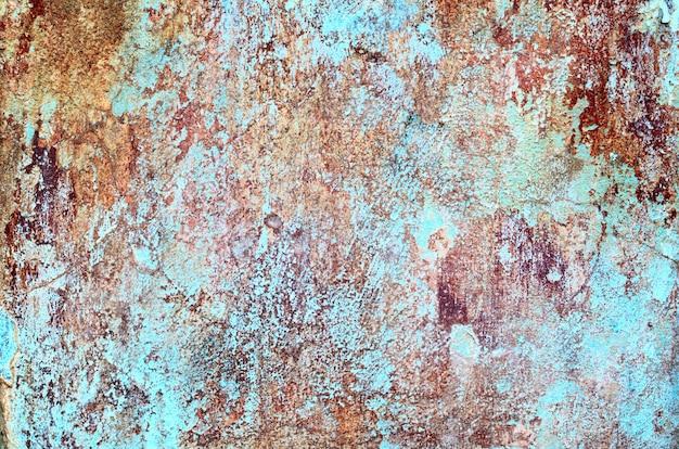 Sjofele grungetextuur van een met pleister bedekte gipsmuur met vele lagen verf