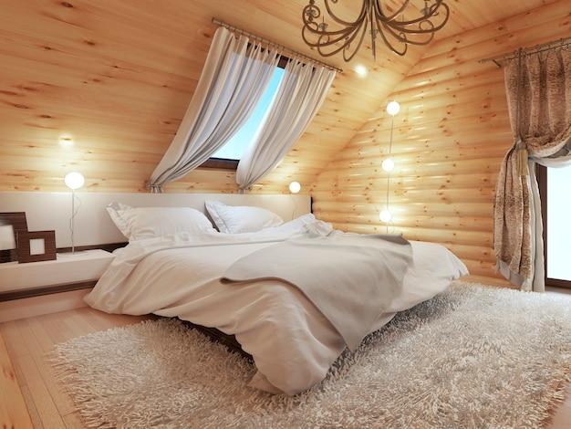 Slaapkamerinterieur in een blokhut op de zolderverdieping met een dakraam