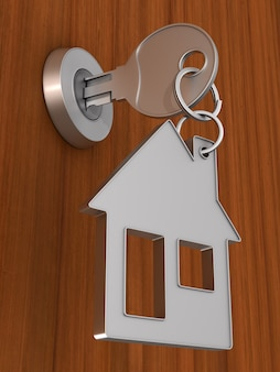 Sleutel en trinket huis op houten achtergrond. 3d-afbeelding