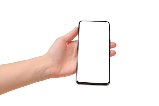 Slimme telefoon in de geïsoleerde hand van de vrouw