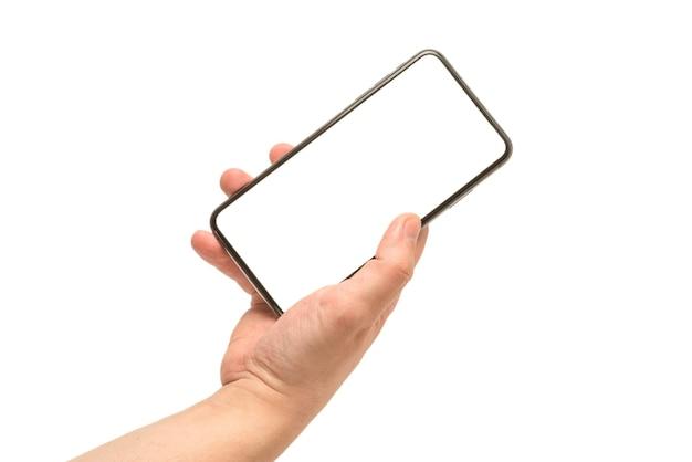 Slimme telefoon in man hand geïsoleerd op wit