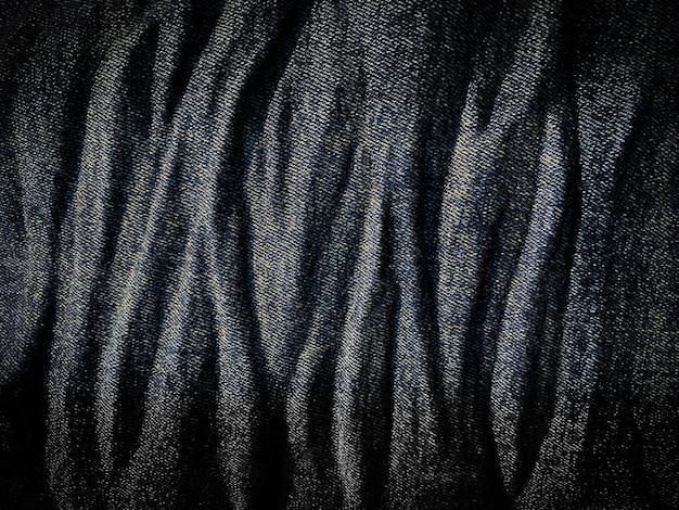 Sluit de blauwe textuur van het denimpatroon