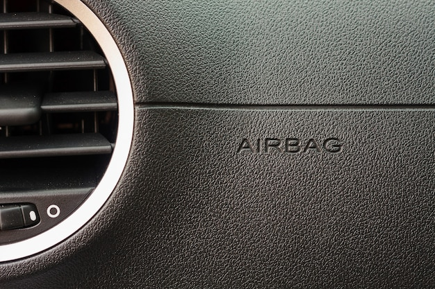 Sluit omhoog airbagteken in de auto