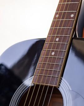 Sluit omhoog detail van gitaarvingerbord, gitaarinstrument, voor musicus, met selectieve nadruk.