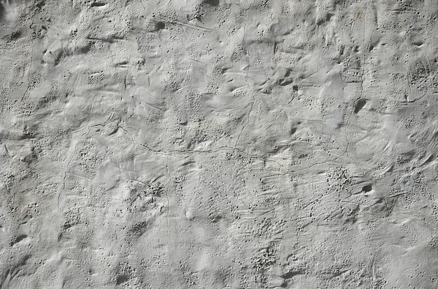 Sluit omhoog geschoten van muur van de grunge de bruine klei op een oud huis