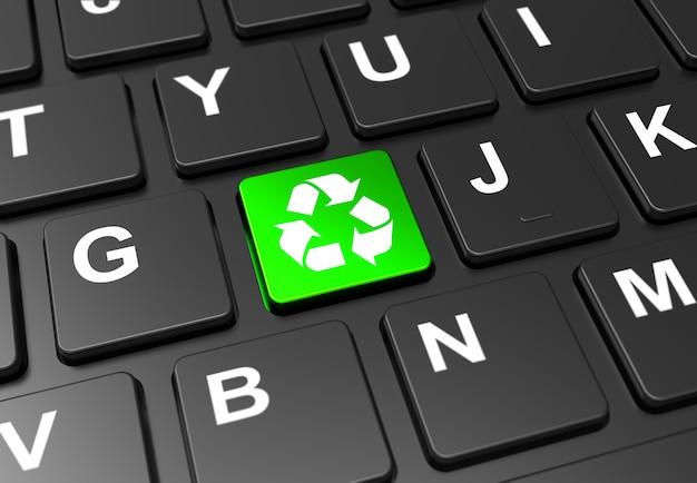 Sluit omhoog groene knoop met kringloopteken op zwart toetsenbord