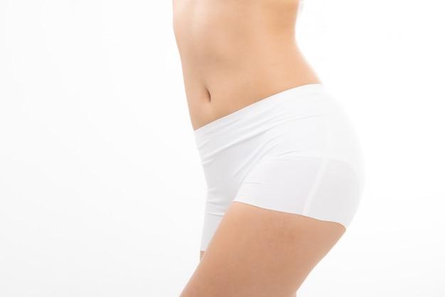 Sluit omhoog het geschikte lichaam van de vrouwen slanke vrouw.
