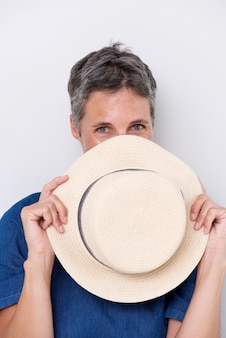 Sluit omhoog het oudere vrouw glimlachen met hoed die gezicht behandelen