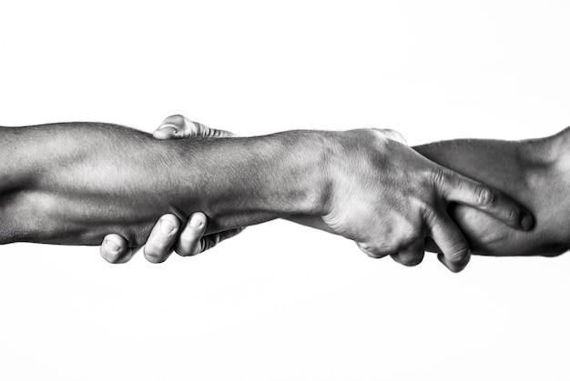 Sluit omhoog hulphand. twee handen, helpende arm van een vriend, teamwork. helpende hand