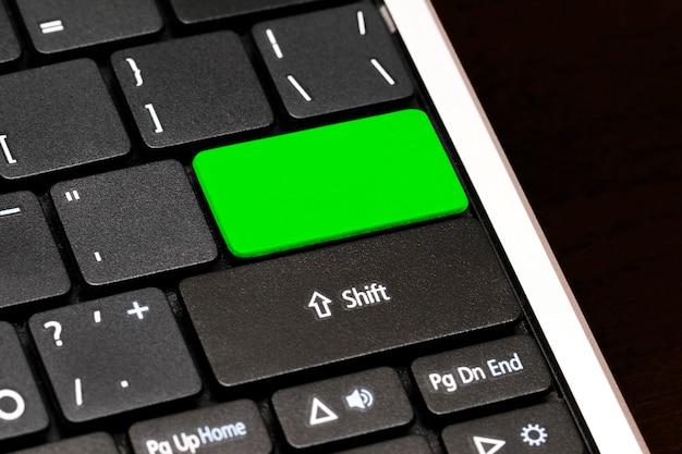 Sluit omhoog lege knoop op laptop toetsenbord.