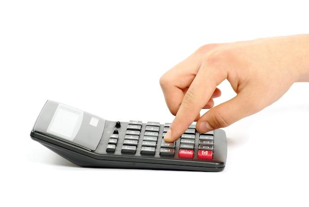Sluit omhoog op calculator met geïsoleerde hand