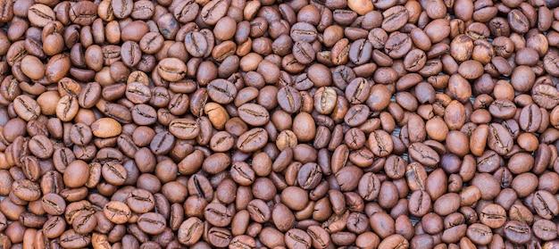 Sluit omhoog op de achtergrond van de textuur van koffiebonen
