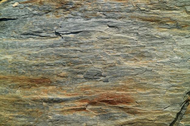 Sluit omhoog op de textuur van het behang van een bergrots