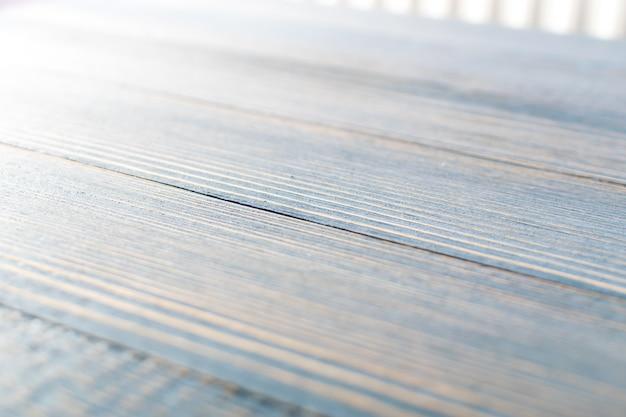 Sluit omhoog op lichtblauwe vage houten achtergrond