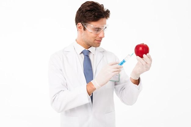 Sluit omhoog portret van een glimlachende jonge mannelijke arts