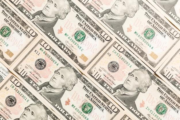 Sluit omhoog van 10 dollarrekeningen als achtergrond