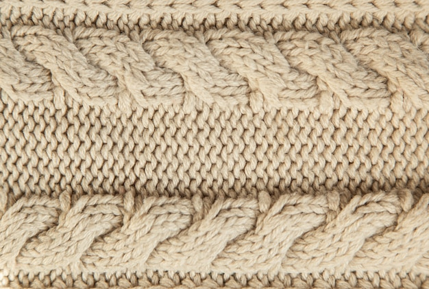 Sluit omhoog van beige gebreide de wintersweater als geweven materieel concept.