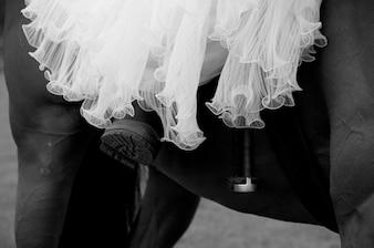 Sluit omhoog van bruid op een paard