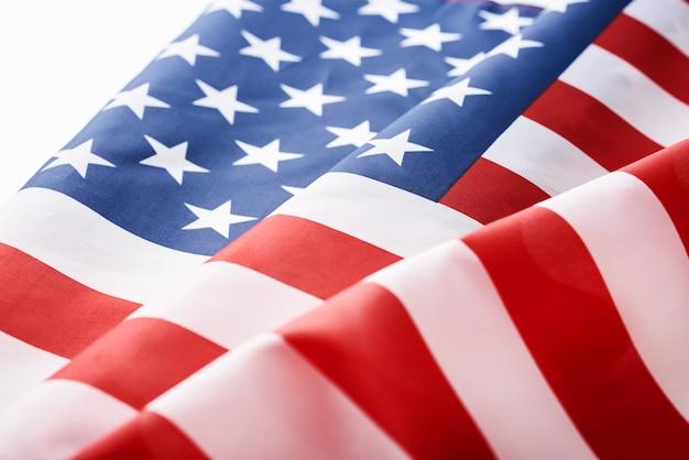 Sluit omhoog van de golvende nationale amerikaanse vlag van de vs concept van memorial of independence day of 4 juli