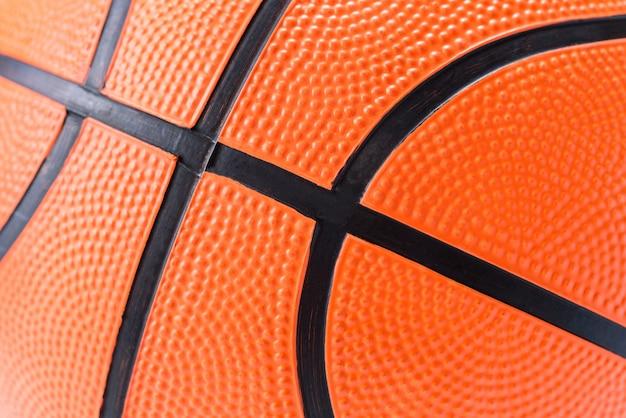 Sluit omhoog van de oranje achtergrond van de basketbaltextuur
