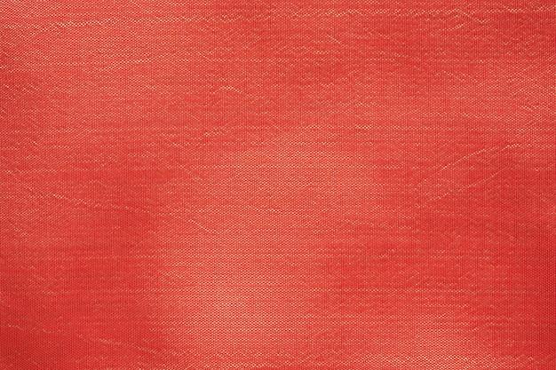 Sluit omhoog van de rode textuur van de zijdestof
