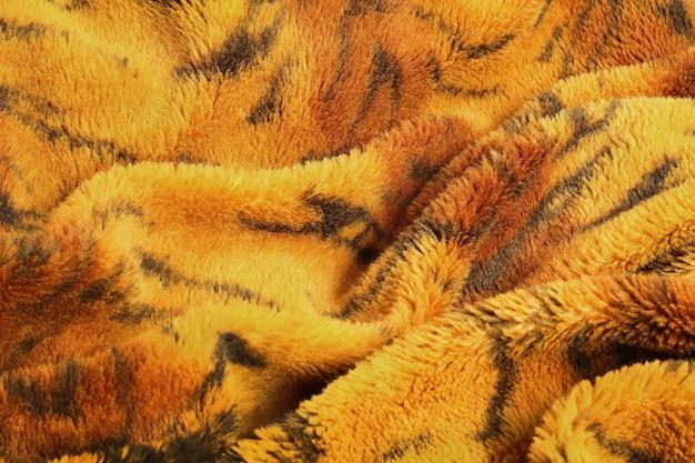 Sluit omhoog van deken op de textuurachtergrond van het tijgerpatroon.
