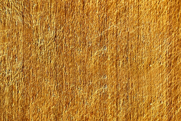 Sluit omhoog van een gele gekraste concrete muurtextuur