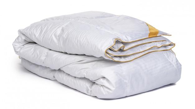 Sluit omhoog van een nieuwe deken die op wit wordt geïsoleerd