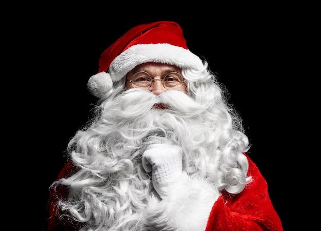 Sluit omhoog van het menselijke gezicht van de kerstman
