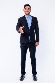 Sluit omhoog van jonge knappe gebaarde perzische zakenman in geïsoleerd kostuum