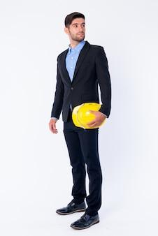 Sluit omhoog van jonge knappe gebaarde perzische zakenman in geïsoleerde de bouwvakker van de kostuumholding