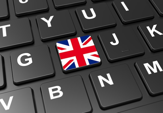 Sluit omhoog van knoop met de vlag van groot-brittannië op zwart toetsenbord