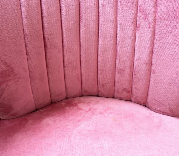 Sluit omhoog van roze van de fluweelstof textuur als achtergrond, zachte pastelkleur roze textiel
