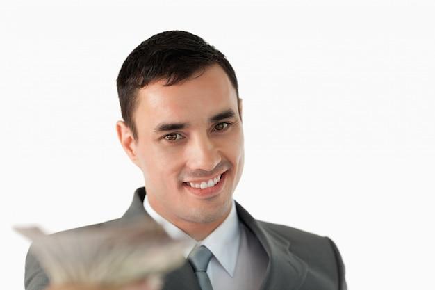 Sluit omhoog van zakenman met bankbiljetten