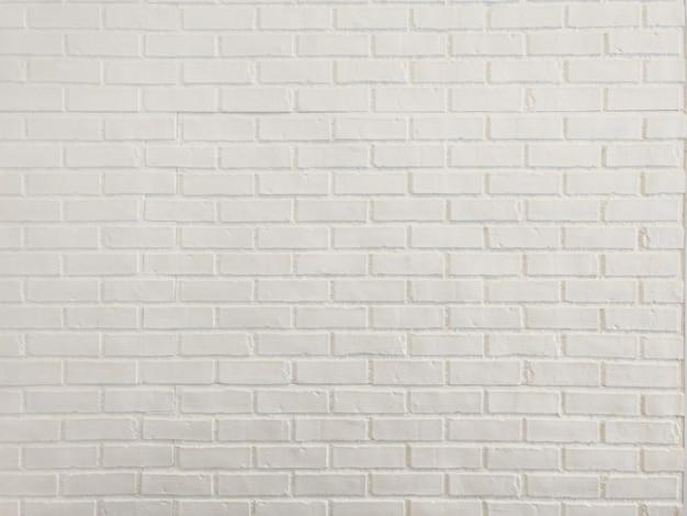 Sluit omhoog witte bakstenen muur