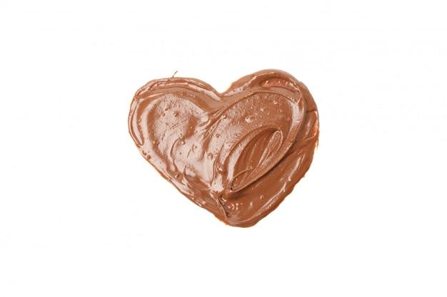 Smakelijke chocolade in de hartvorm die op wit wordt geïsoleerd