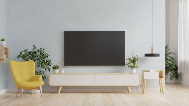 Smart tv op de blauwe muur in de woonkamer met fauteuil, minimaal ontwerp, 3d-rendering