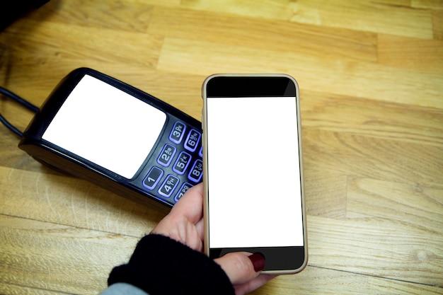 Smartphone en betaalterminal geïsoleerd