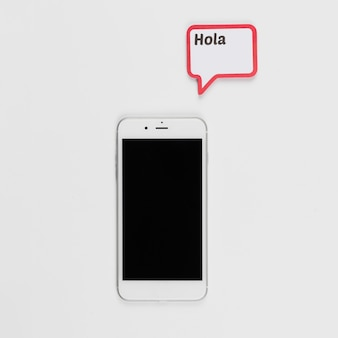 Smartphone en frame met hola-inscriptie