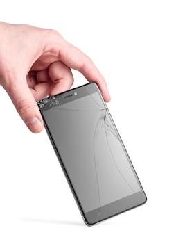 Smartphone met een gebroken scherm in de hand van een man
